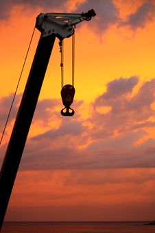 Silhouettes Of A Boom Truck With A Hook At Dawn Royalty Free Stock Photo