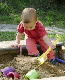 Free Child Playing In Sandbox Royalty Free Stock Photo - 27249505