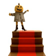 Pumpkin Standing On Red Carpet Staircase Royalty Free Stock Photos