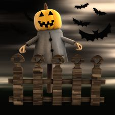 Pumpkin Witch Behind Fence With Bats Stock Photo