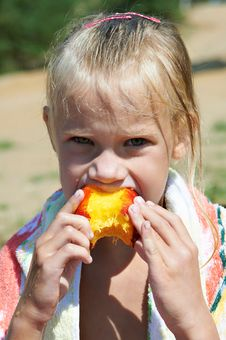 Little Girl Eating A Peach