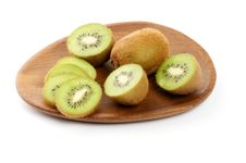 Free Kiwi On Wooden Plate Royalty Free Stock Image - 27262346