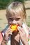 Free Little Girl Eating A Peach Stock Image - 27262001