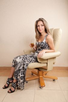 Free Young Woman Sitting In Chair Royalty Free Stock Images - 27273469