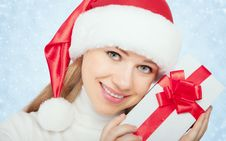 Free Beautiful Woman In A Christmas Hat With Gift Stock Image - 27279471