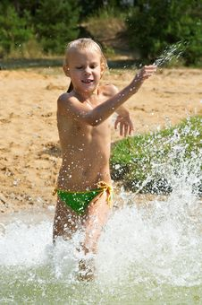 Free Little Girl Running Through The Water Royalty Free Stock Photo - 27280215
