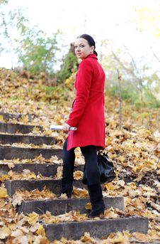 Girl In The Red Coat Is The Ladder Fall Royalty Free Stock Image