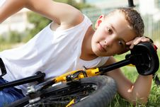 Free Boy Rests With The Bike Stock Photography - 27289272