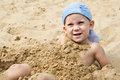 Free Little Boy Lying On The Sand Stock Photo - 27296100