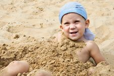 Little Boy Lying On The Sand Stock Photo
