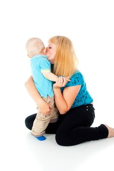 Mother Kissing Little Baby Stock Image