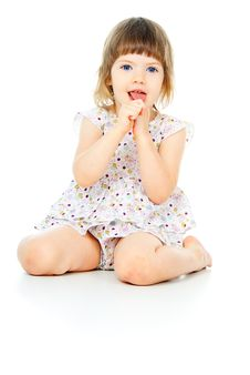 Free Sits A Beautiful Little Girl Royalty Free Stock Photography - 27297107