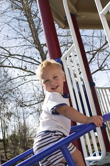 The Boy And The Ladder Royalty Free Stock Photography