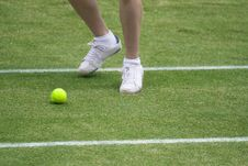 Ball Boy Chasing Tennis Ball Royalty Free Stock Image