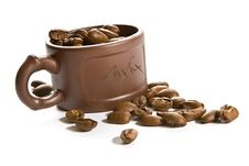 Free Coffee Grains In Brown Cup Stock Image - 2735421
