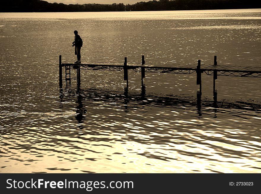 Dock and Fisherman
