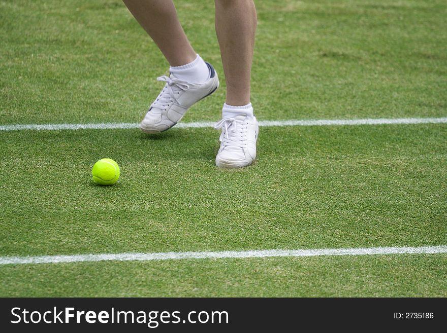 Ball boy chasing tennis ball