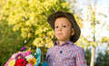 Free Bemused Little Boy With Flowers Stock Photo - 27303740