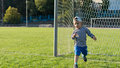 Free Little Boy Running On A Soccer Field Stock Photos - 27303983