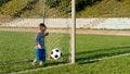 Free Little Goalkeeper Kicking Ball Stock Images - 27304134