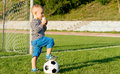 Free Little Soccer Player Drinking Juice Royalty Free Stock Photos - 27304368