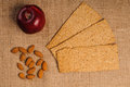 Free Red Apple With Crispbread And Almonds Stock Photo - 27304480
