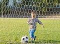 Free Little Boy Kicking A Goal Royalty Free Stock Photo - 27304515