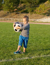 Free Little Boy Holding A Soccer Ball Royalty Free Stock Image - 27304816