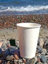 Free Paper Cup On The Pebbles Royalty Free Stock Images - 27306219