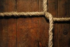 Free Knotted Rope On Wood Royalty Free Stock Photo - 27301745