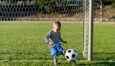 Free Little Boy Kicking A Ball Stock Image - 27304041