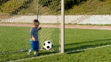 Free Little Goalkeeper Kicking Ball Stock Images - 27304134