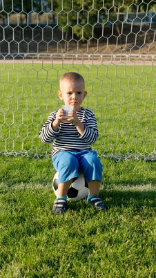 Free Little Boy Drinking While Playing Soccer Royalty Free Stock Photography - 27304187