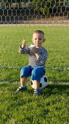 Free Small Boy Sitting On Soccer Ball Royalty Free Stock Photography - 27304247