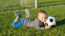 Free Young Boy With A Soccer Ball Stock Image - 27304311