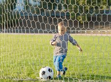 Free Little Boy Kicking A Goal Royalty Free Stock Photo - 27304515