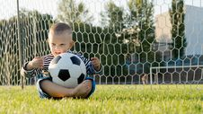 Little Boy With Ball In Goalposts Royalty Free Stock Image