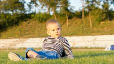Free Little Boy Lying On Green Grass Stock Photography - 27305042