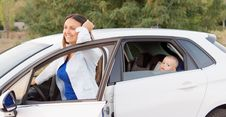 Free Mother Smiling Alongside Her Car Royalty Free Stock Images - 27305229