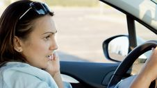 Free Woman Behind The Wheel Of A Car Royalty Free Stock Photos - 27305438