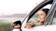 Free Woman Sitting In Car With A Drink Stock Photos - 27305743