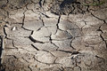 Free Dried Soil Cracking Under The Scorching Sun Royalty Free Stock Photos - 27322478
