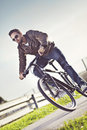 Free Young Man Riding A Bicycle Royalty Free Stock Photography - 27322887