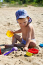 Free Child Playing In The Sand Stock Photography - 27329532