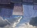 Free Jeans Legs On The Cloudy Sky. Stock Image - 27335761