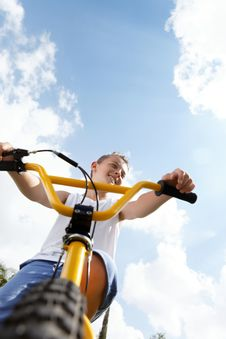 Free Boy On A Bike Outside Stock Photography - 27332372