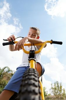 Free Pretty Boy On A Bicycle Outside Royalty Free Stock Image - 27332416