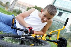 Free Cute Boy With His Bicycle Outside Royalty Free Stock Photography - 27332467