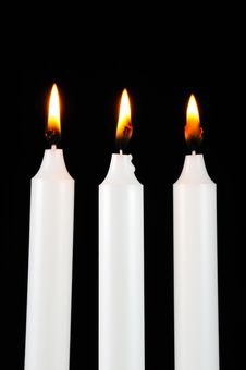 Burning Candles In The Dark Stock Photo