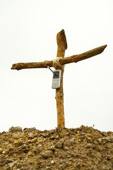 Free Cell Phone On Wooden Cross Stock Image - 27335241